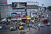 Pedestrians walk around the busy intersection in Mahipalpur in New Delhi, India. Photo: Sanjit Das/Panos