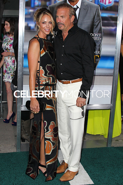 """WESTWOOD, LOS ANGELES, CA, USA - APRIL 07: Christine Baumgartner and Kevin Costner arrive at the Los Angeles Premiere Of Summit Entertainment's """"Draft Day"""" held at the Regency Bruin Theatre on April 7, 2014 in Westwood, Los Angeles, California, United States. (Photo by Xavier Collin/Celebrity Monitor)"""
