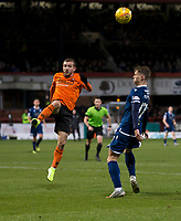 8th November 2019; Dens Park, Dundee, Scotland; Scottish Championship Football, Dundee Football Club versus Dundee United; Paul McMullan of Dundee United clears from Josh McPake of Dundee  - Editorial Use