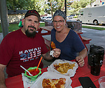 Joe Krivac and Kimberley Hellmers enjoy dinner during Sizzling Saturdays Food Truck event in Sparks on Saturday, July 20, 2019.