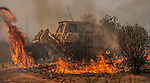 -- Rim Fire-- Bulldozer from Barstow California rushes out fire behind San Jose Family Camp near Yosemite National Park.