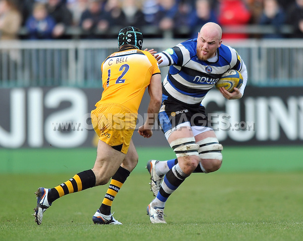 Matt Garvey fends Chris Bell. Aviva Premiership match, between Bath Rugby and London Wasps on February 22, 2014 at the Recreation Ground in Bath, England. Photo by: Patrick Khachfe / Onside Images