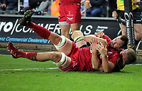 David Bulbring of the Scarlets (FRONT) is grabbed by Olly Cracknell of the Ospreys preventing him from scoring a try during the Guinness PRO14 Round 6 match between Ospreys and Scarlets at The Liberty Stadium , Swansea, Wales, UK. Saturday 07 October 2017