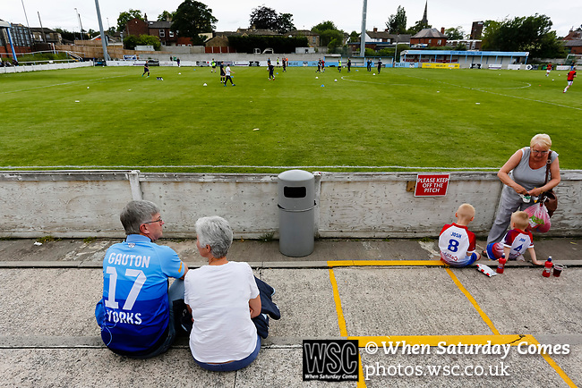Yorkshire fans watching their team warm up. Yorkshire v Parishes of Jersey, CONIFA Heritage Cup, Ingfield Stadium, Ossett. Yorkshire's first competitive game. The Yorkshire International Football Association was formed in 2017 and accepted by CONIFA in 2018. Their first competative fixture saw them host Parishes of Jersey in the Heritage Cup at Ingfield stadium in Ossett. Yorkshire won 1-0 with a 93 minute goal in front of 521 people. Photo by Paul Thompson