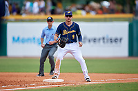 Montgomery Biscuits first baseman Dalton Kelly (9) in front of first base umpire Brock Ballou during a game against the Biloxi Shuckers on May 8, 2018 at Montgomery Riverwalk Stadium in Montgomery, Alabama.  Montgomery defeated Biloxi 10-5.  (Mike Janes/Four Seam Images)