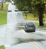 NWA Democrat-Gazette/BEN GOFF @NWABENGOFF<br /> Motorists drive through flood water Sunday, Oct. 6, 2019, on South Osage Road in Rogers.