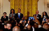 US President Barack Obama speaks at a Hanukkah reception in the East room of the White House while Israeli President Reuven Rivlin (2R), US First Lady Michelle Obama (2L), Nechama Rivlin, the wife of Reuven Rivlin (L) and Rabbi  Susan Talve (R) listen, in Washington, DC, December 9, 2015.  <br /> Credit: Aude Guerrucci / Pool via CNP