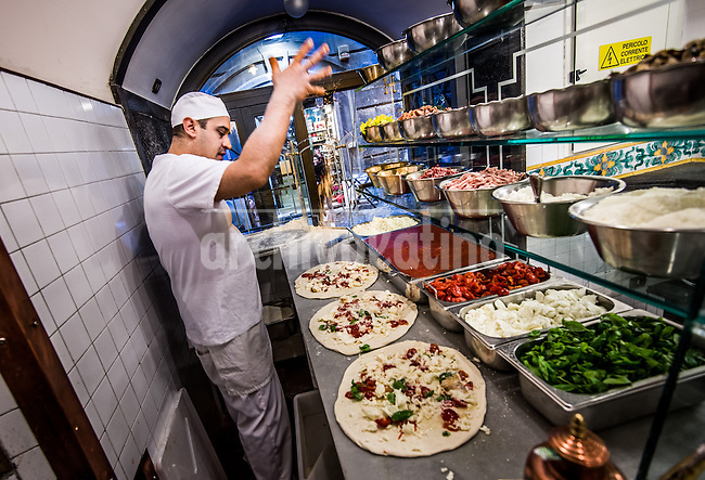 Essay on the Temple of Pizza in Naples , the city where this meal born and developed. Napoli or Naples has unique pizza restaurantes run by a third or fourth generation of cookers. Also called the Meal of the People because in this part of Southern Italy a good pizza costs around 3 euros.