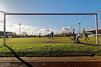 Pictured: A goalkeeper takes a dive during training. Thursday 18 January 2018<br /> Re: Players and staff of Newport County Football Club prepare at Newport Stadium, for their FA Cup game against Tottenham Hotspur in Wales, UK