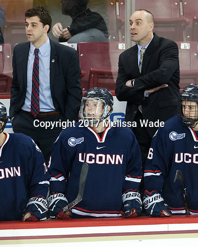 Joe Pereira (UConn - Assistant Coach), Alexander Payusov (UConn - 9), Mike Cavanaugh (UConn - Head Coach), Karl El-Mir (UConn - 16) - The Boston College Eagles defeated the visiting UConn Huskies 2-1 on Tuesday, January 24, 2017, at Kelley Rink in Conte Forum in Chestnut Hill, Massachusetts.