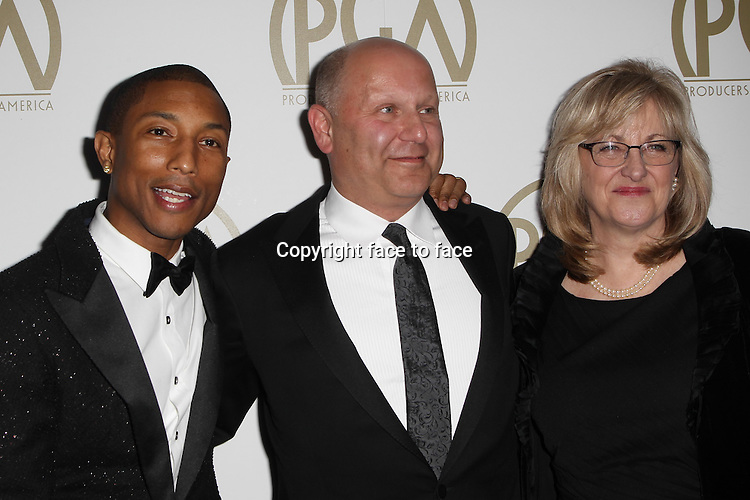 BEVERLY HILLS, CA - JANUARY 19: Pharrell Williams, Christopher Meledandri, Janet Healy attending the 2014 Producers Guild of America Awards in Beverly Hills, California on January 19, 2014.<br />