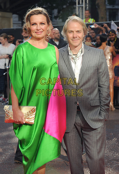 """VESLEMOY RUUD ZWART & HARALD ZWART, director.The Gala Premiere of """"The Karate Kid"""", Odeon Leicester Square, London, England, UK..15th July 2010.half length dress pink gold clutch bag grey gray suit pinstripe green white married husband wife.CAP/BEL.©Tom Belcher/Capital Pictures."""