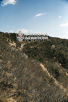 Tourists walk along a trail below the Great Wall at Badaling outside of Beijing, China.