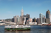 Star Ferry crossing the Victoria Harbour in Hong Kong. The Victoria Habour is famous for its beautiful view. It is also busy with commercial activities..03-07-2003