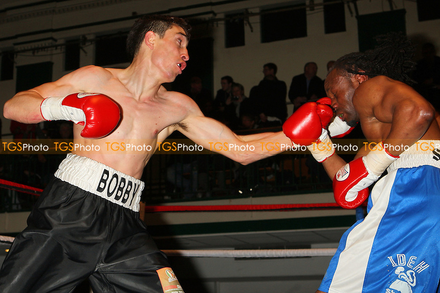 Bobby George (black shorts) defeats Ideh Ockuko in a Light-Welterweight boxing contest at York Hall, Bethnal Green, promoted by Left Jab - 04/03/11 - MANDATORY CREDIT: Gavin Ellis/TGSPHOTO - Self billing applies where appropriate - 0845 094 6026 - contact@tgsphoto.co.uk - NO UNPAID USE.