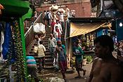 Pedestrians walk down the steps from the Howrah bridge to the Mullik Ghat flower market in Howrah, Kolkata, West Bengal  on Friday, May 26, 2017. Photographer: Sanjit Das