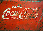 The Antique Gallery of Houston, TX. Old metal coca cola cooler panel.