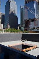 NEW YORK, NY - MAY 12: A view of the south pool waterfall as the construction continues at the World Trade Center site Ground Zero on May 12, 2011 in New York City. More than 2,700 people were killed when hijacked U.S. passenger jets flew into the twin towers of the World Trade Center on September 11, 2001. Nearly ten years after the crippling attacks on Lower Manhattan, business, tourism and new construction like One World Trade Center have rejuvenated the formerly devastated cityscape. (Photo by Per-Anders Pettersson/Getty Images)