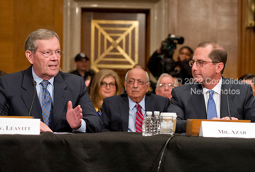Former United States Secretary of Health and Human Services Michael O. Levitt, left, introduces Alex M. Azar II, right, who will testify before the US Senate Committee on Health, Education, Labor and Pensions on his nomination to be Secretary of Health and Human Services on Capitol Hill in Washington, DC on Wednesday, November 29, 2017.<br /> Credit: Ron Sachs / CNP
