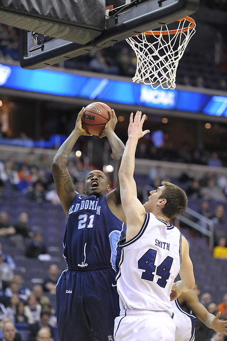 Frank Hassell of the Monarch goes up strong to the basket against Andrew Smith of the Bulldogs. The Butler defeated Old Dominion 60-58 during the NCAA tournament at the Verizon Center in Washington, D.C. on Thursday, March 17, 2011. Alan P. Santos/DC Sports Box