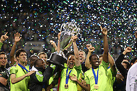 The Seattle Sounders FC celebrate with the Lamar Hunt Trophy. The Seattle Sounders FC defeated the Columbus Crew 2-1 during the US Open Cup Final at Qwest Field in Seattle,WA, on October 5, 2010.