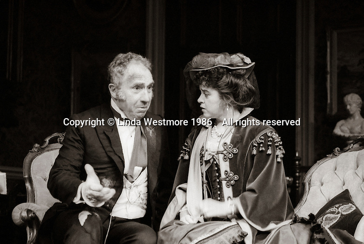 "Mr Posket (Nigel Hawthorne) and Agatha Posket (Gemma Craven) in ""The Magistrate"" by Arthur Wing Pinero, directed by Michael Rudman, designed by Carl Toms, National Theatre, London, 1986."