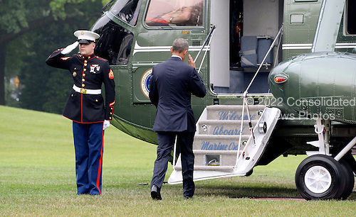 United States President Barack Obama salutes the Marine Guard as he walks to Marine One on the South Lawn of the White House June 16, 2016 in Washington, DC. Obama will travel to Orlando, Florida on Thursday to pay respects to the victims of Sunday's nightclub shooting and to stand in solidarity with the community.<br /> Credit: Olivier Douliery / Pool via CNP