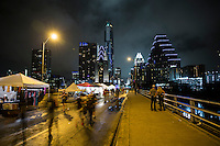 Rows of tents and food vendors line up and down the Congress Avenue Bridge during the annual Bat Fest in downtown Austin, Texas. Although the city experienced heavy rain downpours during the day it did not dampen the sprits of the attendees at the event.  - Stock Image.