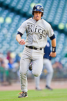 Michael Ratterree #8 of the Rice Owls hustles down the third base line to score a run against the Baylor Bears at Minute Maid Park on March 6, 2011 in Houston, Texas.  Photo by Brian Westerholt / Four Seam Images