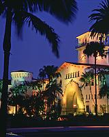 Exterior, evening view of the illuminated Santa Barbara County Courthouse. Santa Barbara, California.