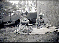 BNPS.co.uk (01202 558833)Pic:    Rowley's/BNPS<br /> <br /> Daphne du Maurier and the Queen Mother - thought to taken during a picnic on a shoot near Balmoral in the 1950's.<br /> <br /> Two previously unknown poems by celebrated writer Daphne du Maurier have been discovered hidden inside a photograph frame.<br /> <br /> They are believed to have been penned in the late 1920s, when she was in her early 20s and an unknown in the literary world.<br /> <br /> The poems were written on a carefully folded sheet of A4 paper concealed within a 5ins high blue leather frame which contained a photo of du Maurier in a swimming costume. <br /> <br /> They were uncovered by an eagle-eyed auctioneer who has been tasked with selling an archive of du Maurier's letters and photos, which includes snaps with the Royals.