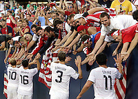 Player of the match Clarence Goodson (3) and his US teammates high five members of Sam's Army after the US victory.  The US Men's National Team defeated Honduras 2-0 in the semifinals of the Gold Cup at Soldier Field in Chicago, IL on July 23, 2009.