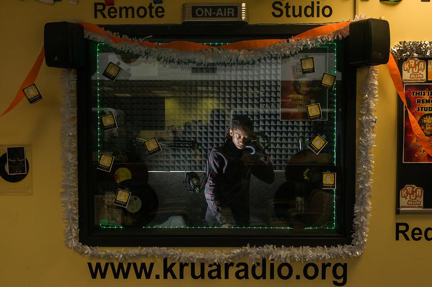 Environment and Society Major Yemi Knight DJs from KRUA radio's remote studio in the Student Union.