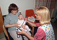 Peadiatric nurse using a probe linked to a digital thermometer to take an infants temperature...© SHOUT. THIS PICTURE MUST ONLY BE USED TO ILLUSTRATE THE EMERGENCY SERVICES IN A POSITIVE MANNER. CONTACT JOHN CALLAN. Exact date unknown.john@shoutpictures.com.www.shoutpictures.com..