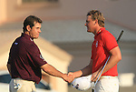 Robert Karlsson shakes Lee Westwood's hand after finishing their round  during the Final Day of the Dubai World Championship, Earth Course, Jumeirah Golf Estates, Dubai, 28th November 2010..(Picture Eoin Clarke/www.golffile.ie)