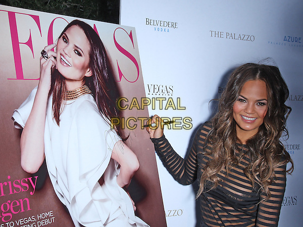 Chrissy Teigen<br /> Vegas Magazine celebrates its summer issue with cover star Chrissy Teigen at Azure Luxury Pool at the Palazzo, Las Vegas, Nevada, USA.<br /> 24th July 2013<br /> half length black sheer stripe to see through thru bra signing autograph christine <br /> CAP/ADM/MJT<br /> &copy; MJT/AdMedia/Capital Pictures