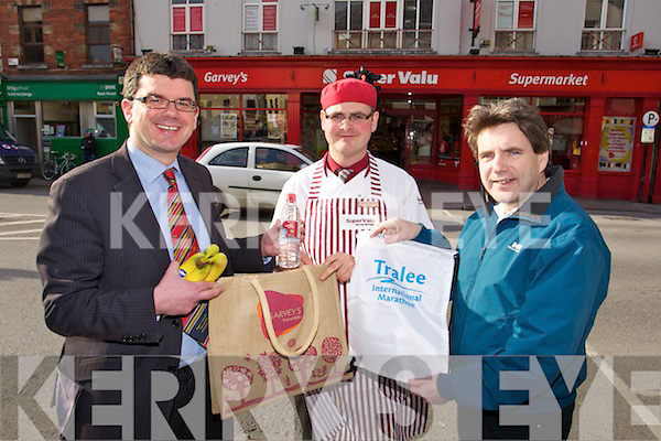 Getting the goodie bags ready for Tralee International Marathon on Thursday last were l-r: Jim Galvin (Finance Director of Garvey's Group) Andrew Barrett (Butcher, Garvey's) and Marcus Howlett (race director of Tralee International Marathon)..