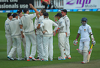 The Black Caps celebrate Doug Bracewell's dismissal of Kaushal Silva during day one of the 2nd cricket test match between the New Zealand Black Caps and Sri Lanka at the Hawkins Basin Reserve, Wellington, New Zealand on Saturday, 3 February 2015. Photo: Dave Lintott / lintottphoto.co.nz