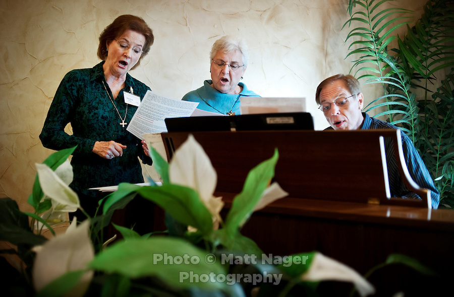 From left, Marilyn Jones (cq), Mary Lu Powell (cq), and organist Michael Reed (cq), rehearse for the St. Stephen's Episcopal Church chior before church services at a rented wedding chapel in Hurst, Texas, USA, Sunday, Nov. 1, 2009. The St. Stephen's Episcopal Church in Hurst, Texas has come to represent a recent change of the Episcopal church which now ordains openly gay priests and offers alternative ideas towards the future for Episcopalians. St. Stephen's has split into two factions due to differing opinions on the future of the church...CREDIT: Matt Nager for The Wall Street Journal