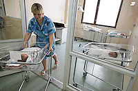 "Yulia Smirnova waits to be released at the Moscow Planning Center and Reproduction Maternity Home. Yulia made the decision on a 2nd child based on the fact that she would get ""mother's capital"" and they could move out of the one room they share with their daughter in their mother-in-law's apartment.  Once she had the child she loved it so much she wondered why the money was the main motivation... because she was so happy to have the 2nd child..The maternity home delivers about 8000 children a year... about 20 a day or so... This is the most of any maternity hospital in Russia.  There are 117,000 delivered in 2009 in all of Moscow.  1,800,000 were born in Russia in 2009 which is 27,000 more than the deaths that year.  So Russia is basically at the replacement rate, but there are not as many breeders in the lineup moving forward... so the state has instituted a number of policies including free housing for immigrants and a one time payment of over $10,000 for a woman to have either the 2nd, 3rd or 4th baby."
