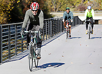 NWA Democrat-Gazette/DAVID GOTTSCHALK  Jack Lyons (from left) leads Bret Shulte and Geoff Brock as they travel south Thursday, November 12, 2015, on the Razorback Greenway near Shiloh Square in Springdale.