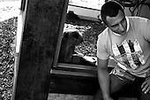 Wroclaw, Poland, April 4, 2009:<br /> Krzysztof Golaszewski by the gibbon, at the Wroclaw Zoo.(Photo by Piotr Malecki / Napo Images)..Odwiedzajacy Krzysztof Golaszewski i gibon w Zoo..Wroclaw, Kwiecien 2009.Fot: Piotr Malecki / Napo Images