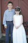 Molly-Ann Rath with her brother Morgan at her First Communion in Clogherhead church on Saturday.