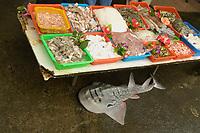 Bowmouth guitarfish shark ray, Rhina ancylostoma, and seafood for sale at Nanfang'ao fish market, Suao, Taiwan Republic of China