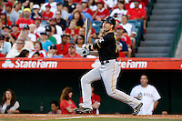 Neil Walker #18 of the Pittsburgh Pirates bats against the Los Angeles Angels at Angel Stadium on June 21, 2013 in Anaheim, California. (Larry Goren/Four Seam Images)
