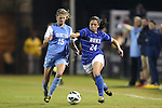 18 October 2012: Duke's Mollie Pathman (24) and UNC's Katie Bowen (NZL) (15). The University of North Carolina Tar Heels defeated the Duke University Blue Devils 2-0 at Koskinen Stadium in Durham, North Carolina in a 2012 NCAA Division I Women's Soccer game.