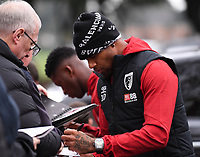 23rd November 2019; Vitality Stadium, Bournemouth, Dorset, England; English Premier League Football, Bournemouth Athletic versus Wolverhampton Wanderers; Jordon Ibe of Bournemouth signs autographs as he arrives at Vitality Stadium - Strictly Editorial Use Only. No use with unauthorized audio, video, data, fixture lists, club/league logos or 'live' services. Online in-match use limited to 120 images, no video emulation. No use in betting, games or single club/league/player publications