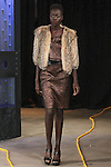 Nyamouch (Fenton Models) walks runway in an outfit from the Saunder Fall Winter 2016 collection by Emily Saunders during New York Fashion Week Fall 2016.
