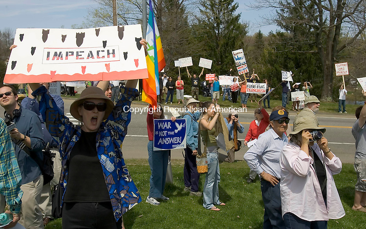 KENT, CT-25 APRIL 2008 --042508JS04--Protesters raise their signs toward a military helicopter that flew near the Warren Congregational Church on Friday as they gathered to protest the visit of President George W. Bush to the home of former U.S. Secretary of State Henry Kissinger in Kent. President Bush was visiting as part of a fund-raiser lunch for congressional candidate David J. Cappiello (R-Danbury).<br /> Jim Shannon / Republican-American