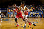 BROOKINGS, SD - FEBRUARY 23: Brandon Key #0 of the South Dakota State Jackrabbits drives to the basket past Ty Chisom #1 of the South Dakota Coyotes Sunday at Frost Arena in Brookings, SD. (Photo by Dave Eggen/Inertia)